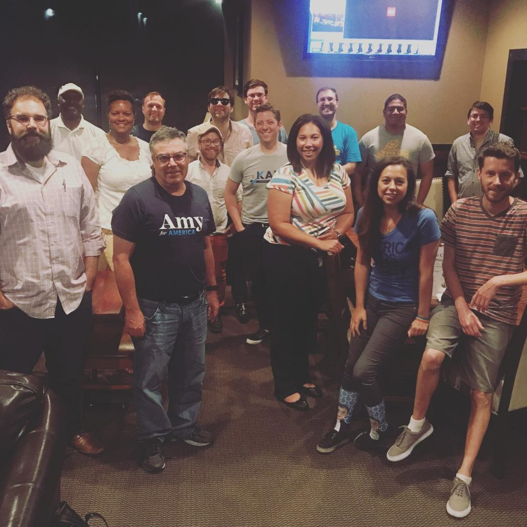 Hamilton County Young Democrats standing together after watching the Democratic Presidential Debates at Wolfies Grill in Carmel