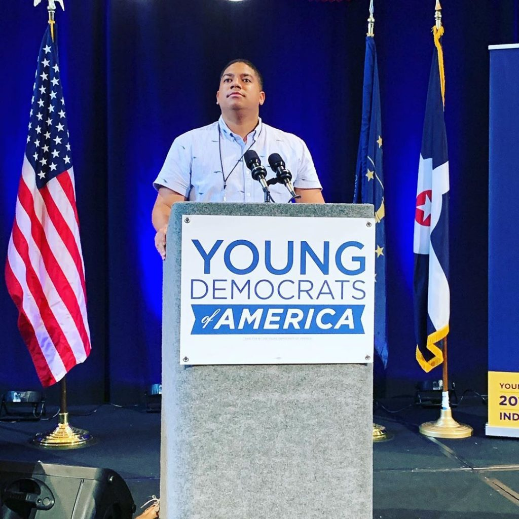Hamilton County Young Democrats behind the podium and microphone by the flag on the official stage of the Young Democrats of America National Convention in Indianapolis 2019