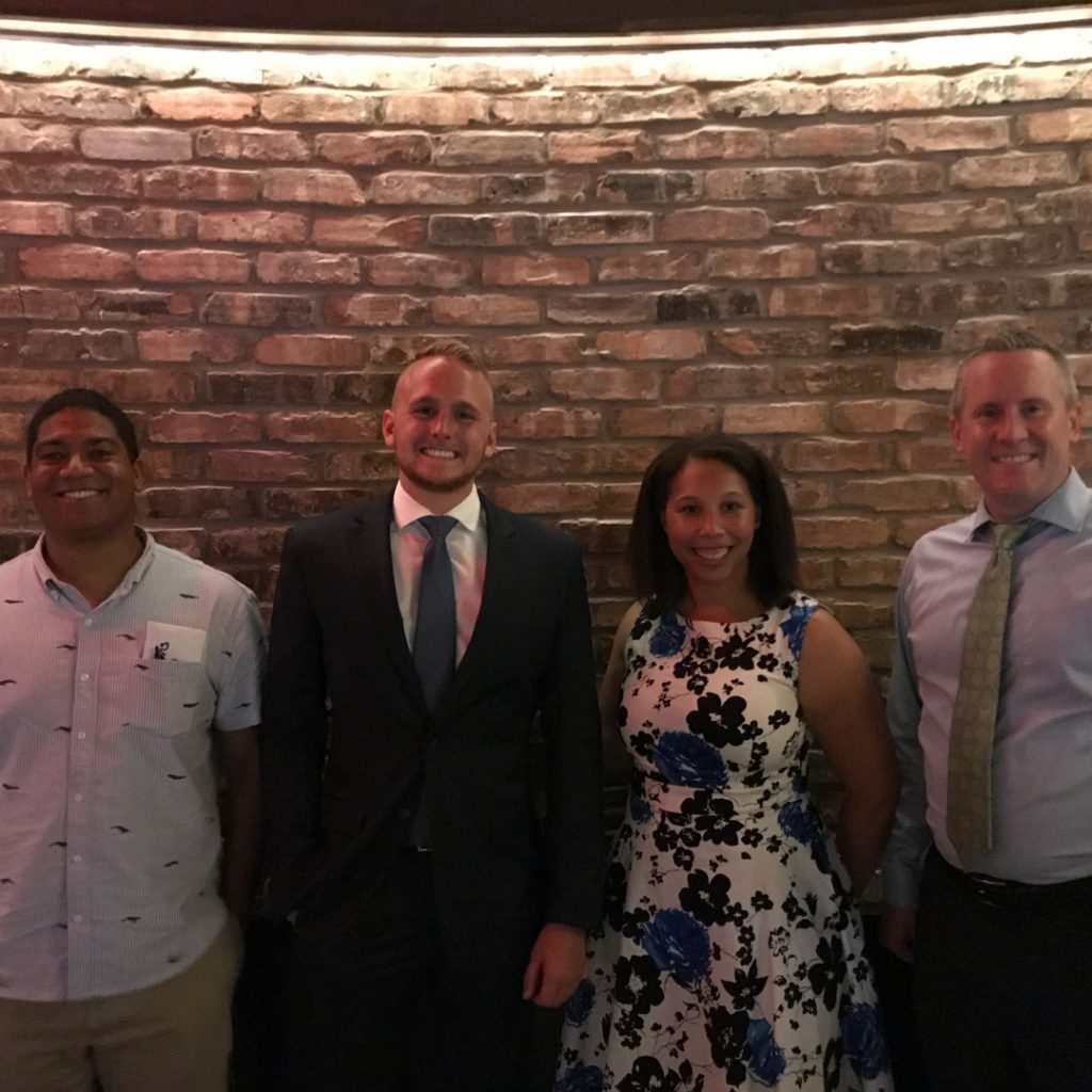 Indiana Democratic Chair John Zody standing with the Hamilton County Young Democrats at Bar Louie in Carmel 2018