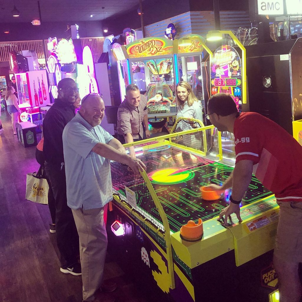 Hamilton County Young Democrats on a social night playing air hockey at the arcade at Pinheads in Fishers